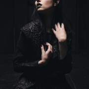 Tattooed Fashion model in black leather coat