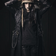 Alicia Vigil, Tattooed Fashion model in black leather coat