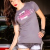Brunette fashion model in Urban Outlaw Racing T-shirt stands next to porsche 911