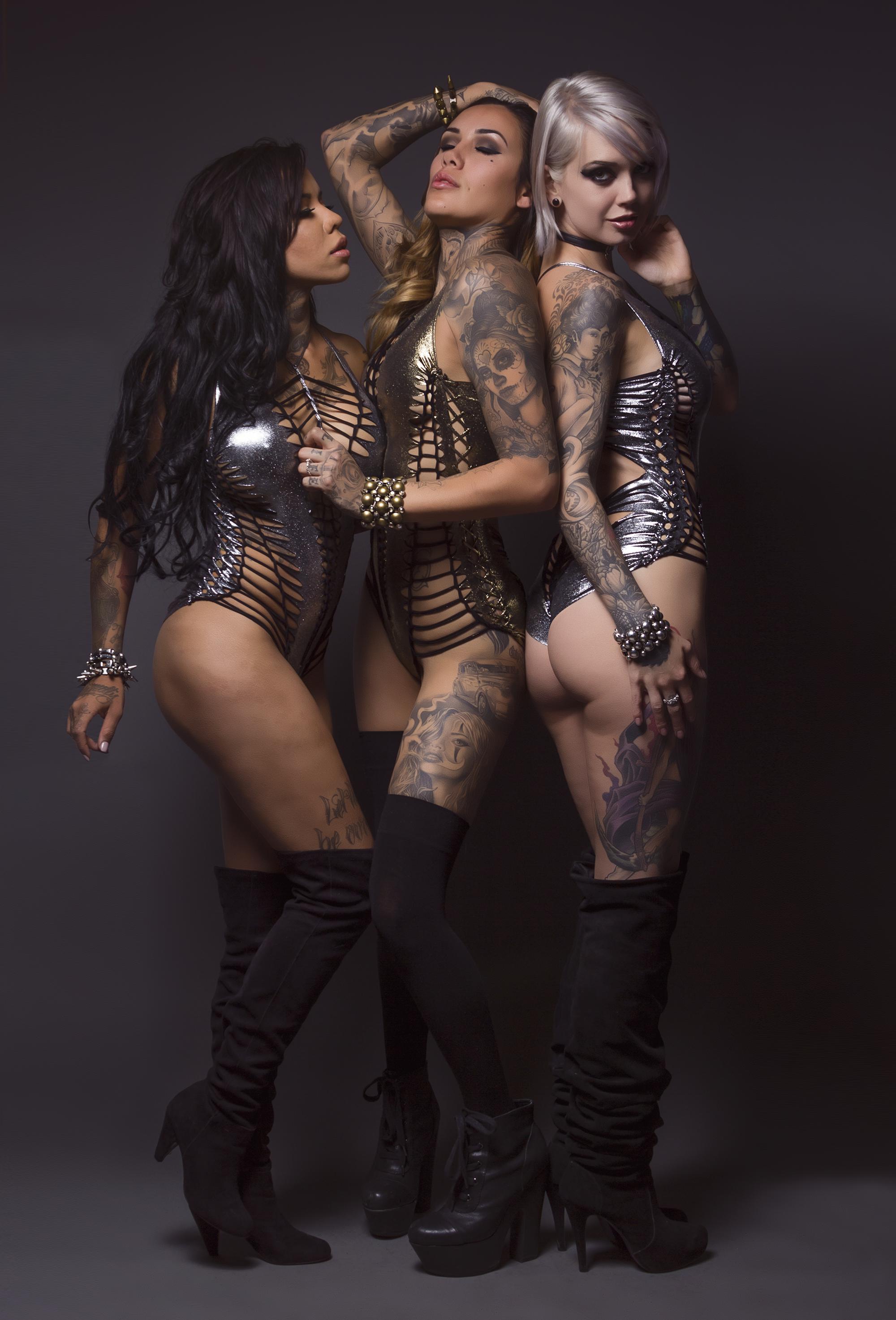 three inked fashion models in Peepshow Clothing bodysuits.