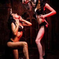 Zombie blood poured onto fashion model in black underwear