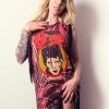 Blonde tattooed model in David Bowie fringe dress.