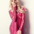 Blonde tattooed model in pink fringe dress.