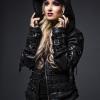 Blonde model in black leather by Junker Designs