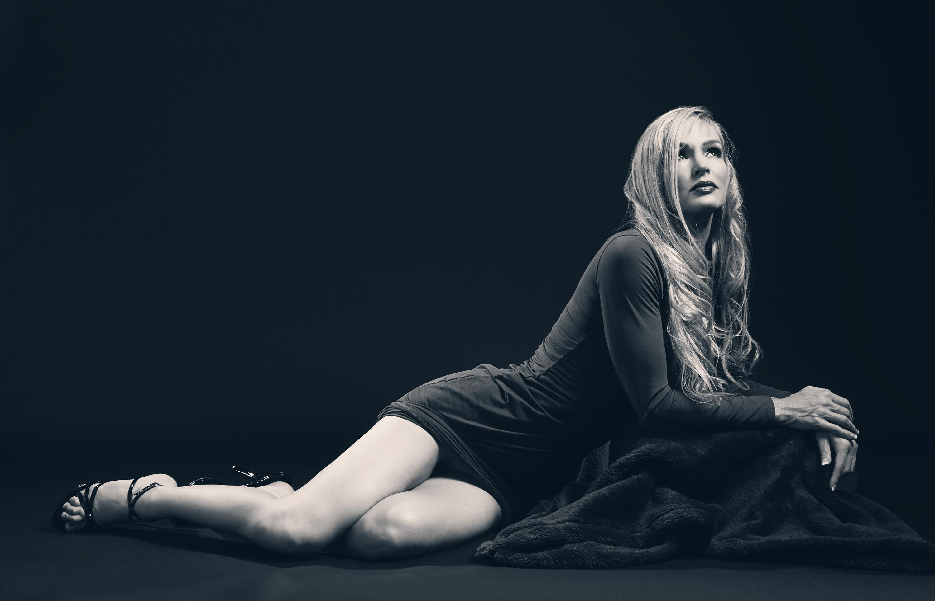 Classic looking blonde model in knee length dress photographed in black and white