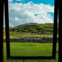 View of Timsgarry through a large window on a sunny day