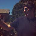 Smoking man holds crawfish in Hollywood